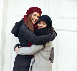 Happy Women Embracing on a Cold Winter