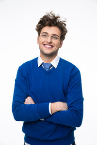 Happy young business man in glasses with arms folded over gray background