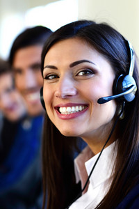 Happy young businesspeople and colleagues in a call center office