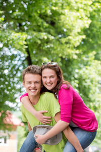 Happy young couple posing in nature