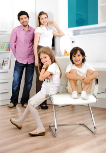 Happy young family together at home posing for portrait