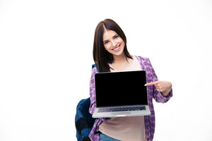 Happy young woman showing finger on laptop screen