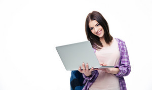 Happy young woman standing with laptop