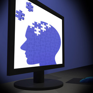 Head Puzzle On Monitor Showing Human Brightness