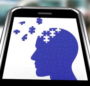 Head Puzzle On Smartphone Shows Smartness