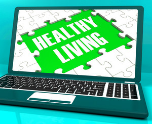 Healthy Living On Laptop Shows Wellbeing
