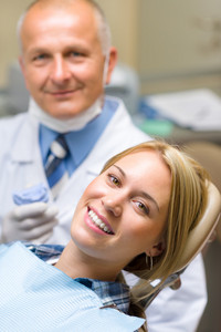 Healthy patient at dentist office have teeth checkup stomatology