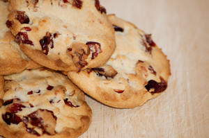 Heap Of Cranberry Cookies On Wooden Plate
