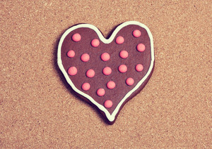 Heart shaped cookie on cork surface