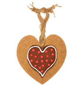 Heart shaped cookie on wooden heart