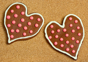 Heart shaped cookies on cork surface