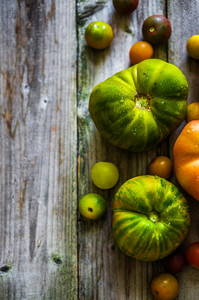 Heirloom Tomatoes On Rustic Background