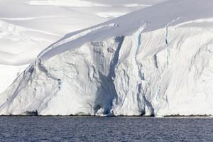 High, snowy cliffs along the coast