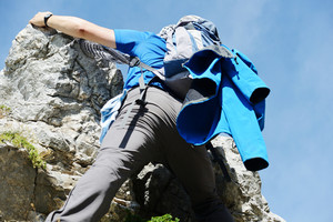 Hiking and climbing on rock in mountains