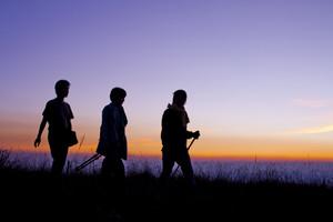 Hiking scene with silhouette people walking