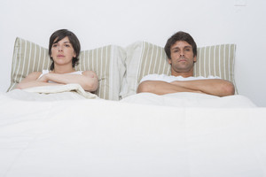 Hispanic couple in bed