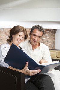 Hispanic couple in living room
