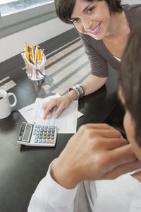 Hispanic couple managing finances
