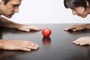 Hispanic couple with apple