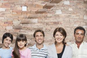 Hispanic family sitting in living room
