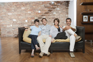 Hispanic family sitting in living room