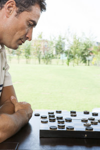 Hispanic men playing checkers