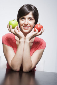 Hispanic woman with apples