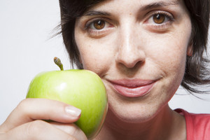 Hispanic woman with apples