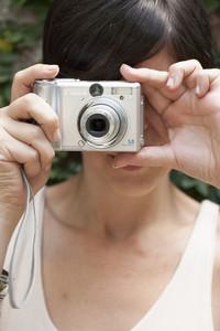 Hispanic woman with camera