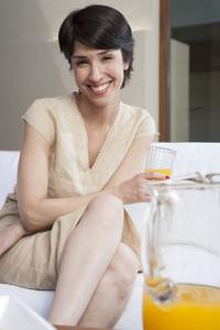 Hispanic woman with juice