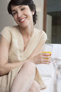 Hispanic woman with juice