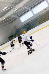Hockey players on a fast break as they speed down the ice.