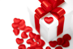 Holiday gift box with red hearts