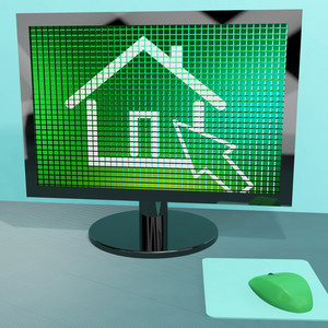Home Symbol On Computer Screen Showing Real Estate Or Rentals