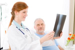 Hospital - female doctor examine senior patient x-ray