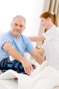 Hospital - female nurse take care of patient with broken leg