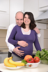 Husband and wife in kitchen