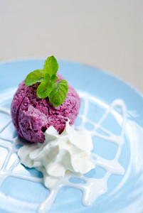 Ice-cream with a currant and mint on a table