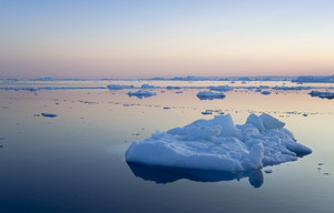 Ice floes in still waters at sunset