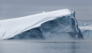 Iceberg against a grey sky