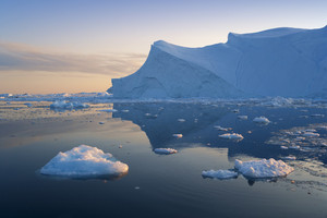 Iceberg and ice chunks at dusk