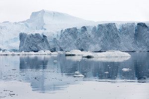 Iceberg and ice floes reflected in the water