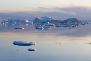 Iceberg illuminated at dusk