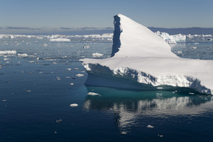 Iceberg reflected in icy waters