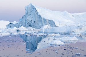 Iceberg reflected in water