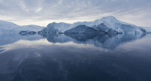 Iceberg under a cloudy sky