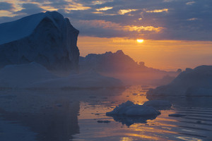 Icebergs against a golden sunset