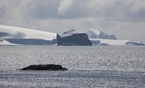 Icebergs under a cloudy sky
