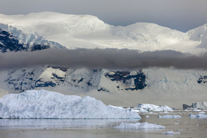 Icebergs under a foggy sky