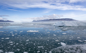 Icy waters and iceberg along the coast